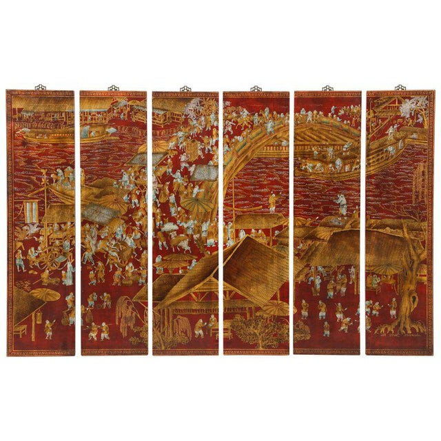 A set of six chinoiserie panels lacquered in a deep red with accents of gold and teal blue. This work of art depicts a...