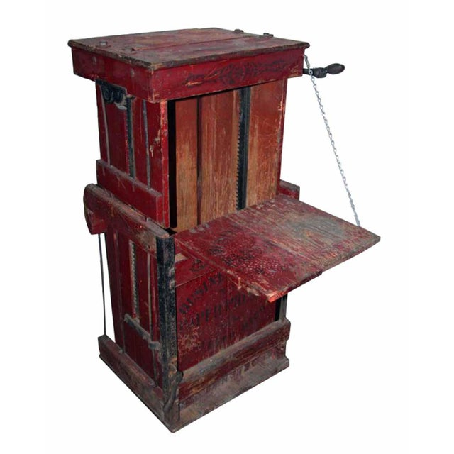 Antique book press with original red paint and stenciling. Patent date February 28, 1910.