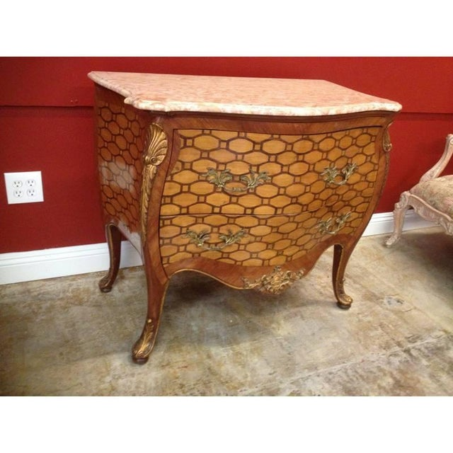 Impressive and unique late 19th-early 20th century Italian Rococo style inlaid bombe commode. Beige serpentine-fronted...