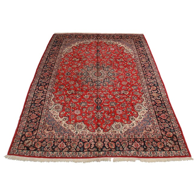 Vintage hand knotted wool Persian Isfahan rug. Center medallion design with nice blues and red. Very fine quality rug. Red...