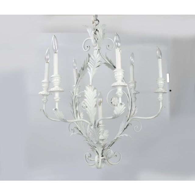 Italian seven light leaf and flower chandelier in white. In working condition; takes seven 25 watts max bulbs. Chain, 22...