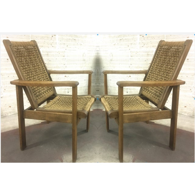 French Riviera style pair of reclining rope lounge chair.