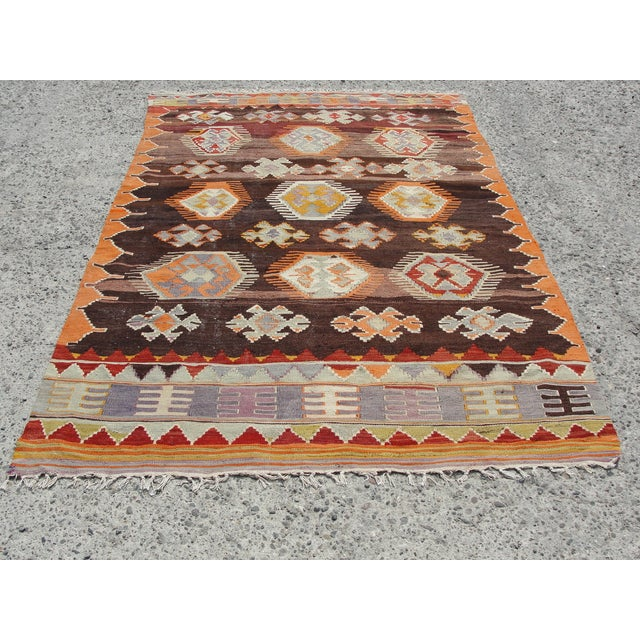 Vintage handwoven Turkish kilim rug. The kilim is nearly 50 years old. It is handmade, of very fine quality natural wool...