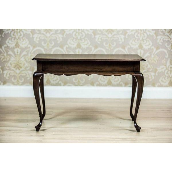 We present you a small, low table with a rectangular top, supported on bent legs.This piece of furniture is modern,...
