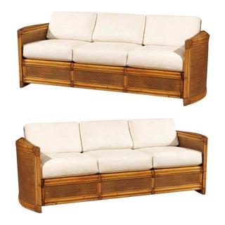 Exceptional Pair of Restored Vintage Rattan Sofas For Sale