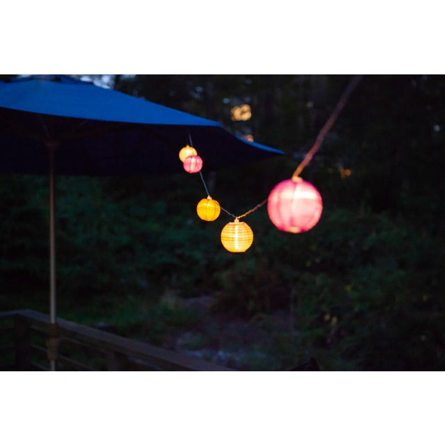 Textile Glow Outdoor Solar String Lights in Peach Bellini For Sale - Image 7 of 9