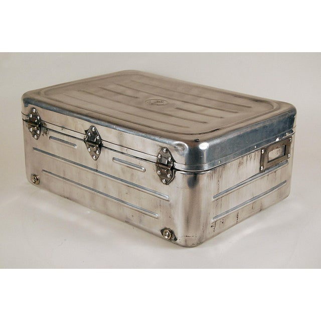 Navy issued stainless metal case. Great Patina, with a few dents, that show its age. Great accessory item for Traditional...
