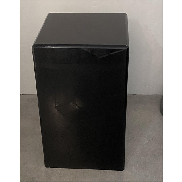 This black Lucite pedestal dates to the 1990s.
