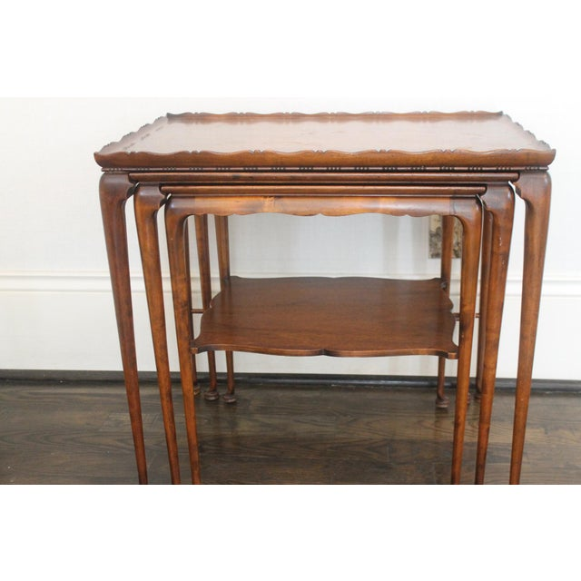 18th century English/ Mahaghony nesting tables, with beautiful pantina. These nesting tables have a lovely dental molding...