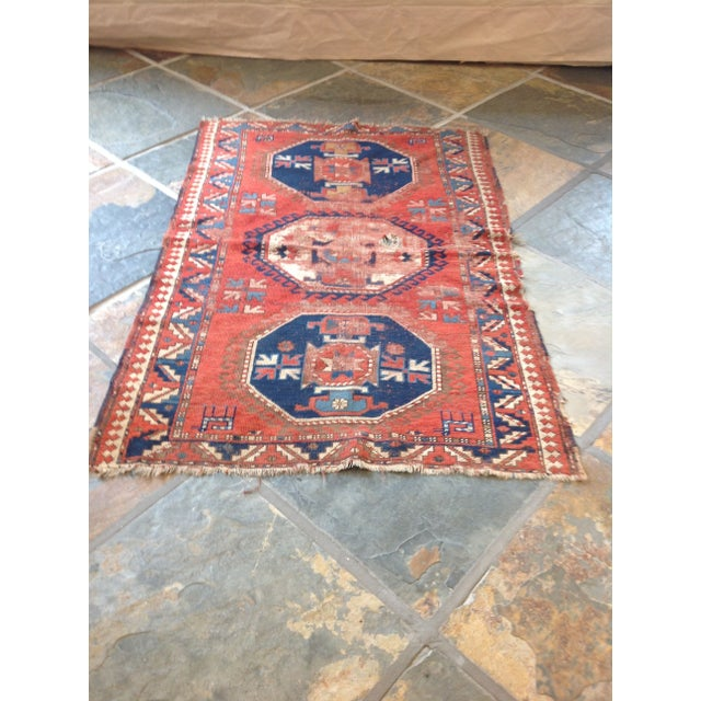 This antique Persian Rug epitomizes the style of Northwest Persia with its dramatic rectilinear designs and strong color...