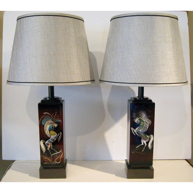 A pair hand painted ceramic lamps from the studio of Sascha Brastoff (signed), ca. 1950. Features painted blue-green-coral...