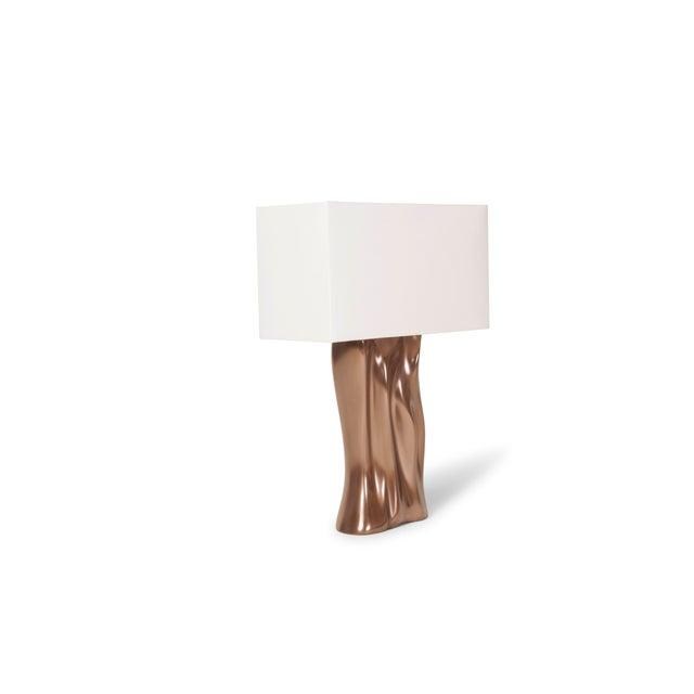 "Doris table lamp, Bronze finish. Base dimensions: 11"" W x 6"" D x 18"" H Shade: White silk, shade dimensions: 8"" x 18"" x 10""..."