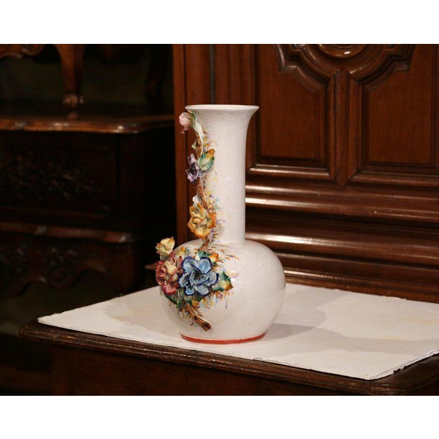 This tall and colorful Majolica vase was created in France, circa 1920. The large circular vase features hand-painted...