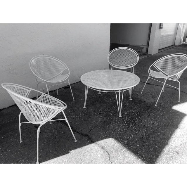 "This stylish mid-century modern""radar-hoop"" patio set was designed by Tempestini and sold by Salterini and was..."