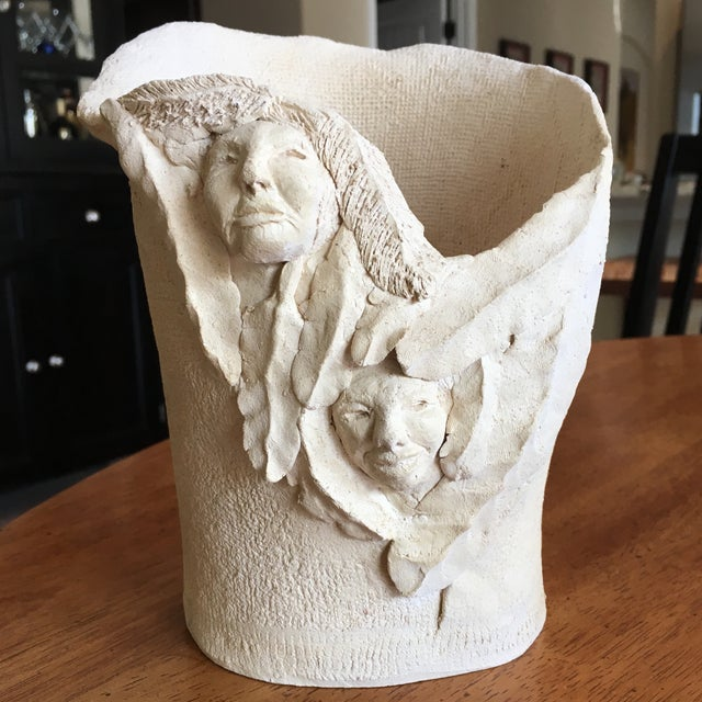 "This vintage Vase is signed by the artist and is a free form style and is unglazed in a cream color. Stands 7.5"" tall and..."