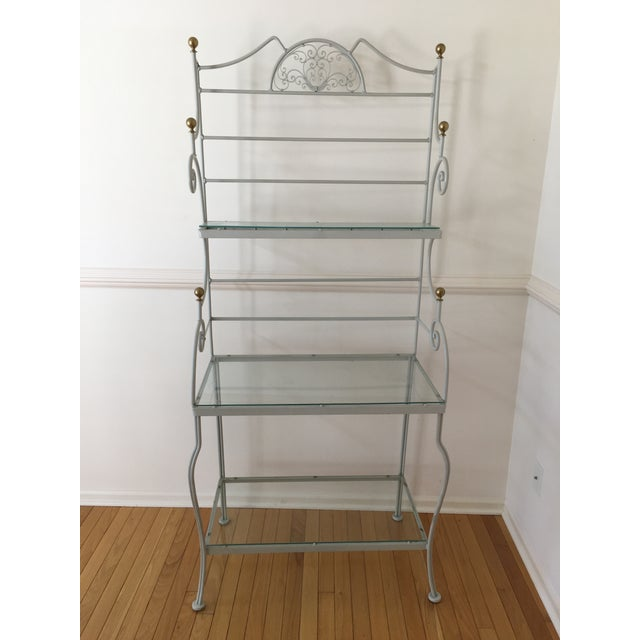 Vintage Woodard 3 tier bakers rack with brass knobs . Includes 3 glass shelves and 7 hooks for hanging utensils or cups ....