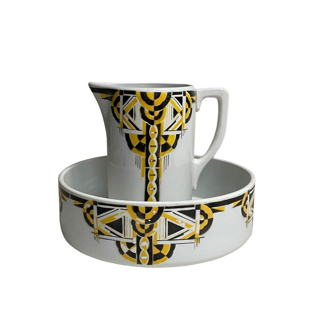 A wonderful necessaries set for display. White glazed with a yellow and black asymmetrical design this art deco pitcher...