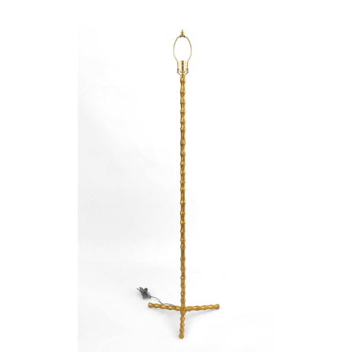 French 1950s gilt bronze faux bamboo design floor lamp resting on 3 feet style of Baguès.