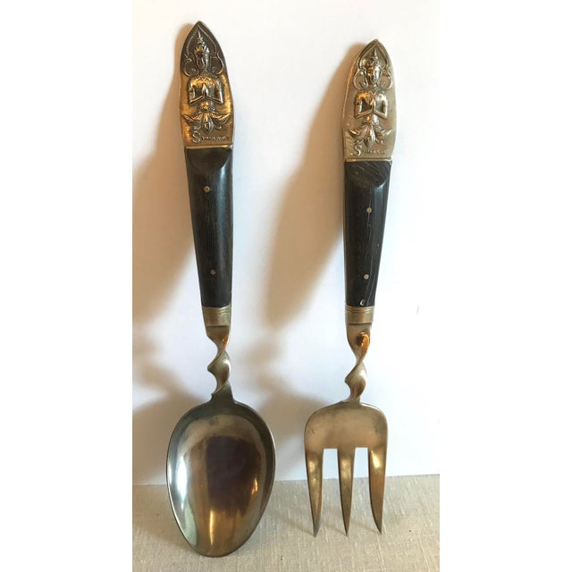 Nice brass and rosewood salad serving set from Thailand. Includes 2 pieces - the fork and spoon. Nice detail on handles....