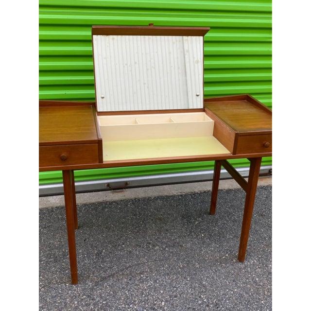 1960's Danish Teak wood lift top vanity or dressing table with mirror inside. All original.