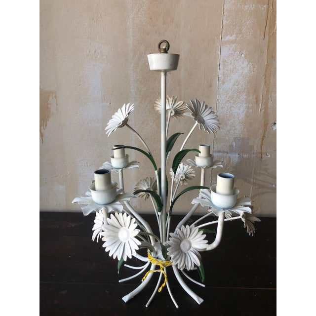 Vintage Tole Chandelier with Daisies. This vintage tole chandelier is a bouquet of daisies and has four arms for lights....