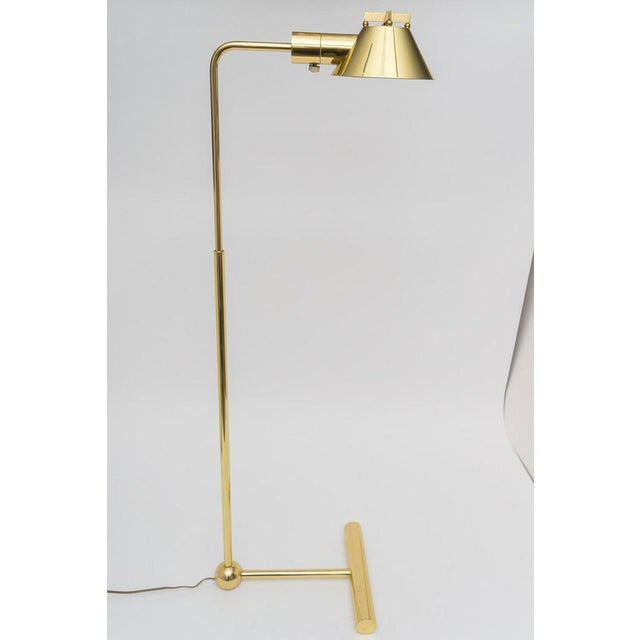 This stylish and rare-form adjustable floor lamp by Casella Lighting has been professionally polished and lacquered (no...