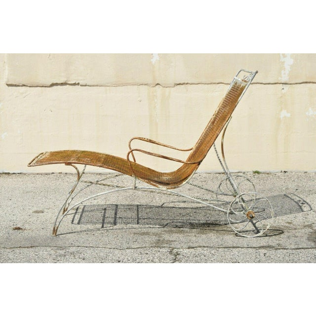 Pair of Vintage Mid Century Modern Russell Woodard Wrought Iron Sculptural Patio Chaise Lounge Chairs. Item features wide...