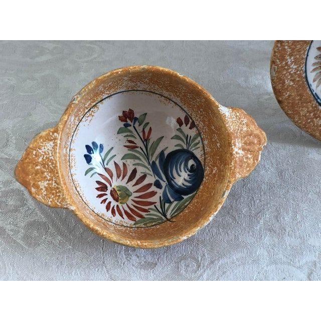 This circa 1930s Henriot Quimper French pottery double handle bowl & plate set has an unusual orange sponge-painted border...