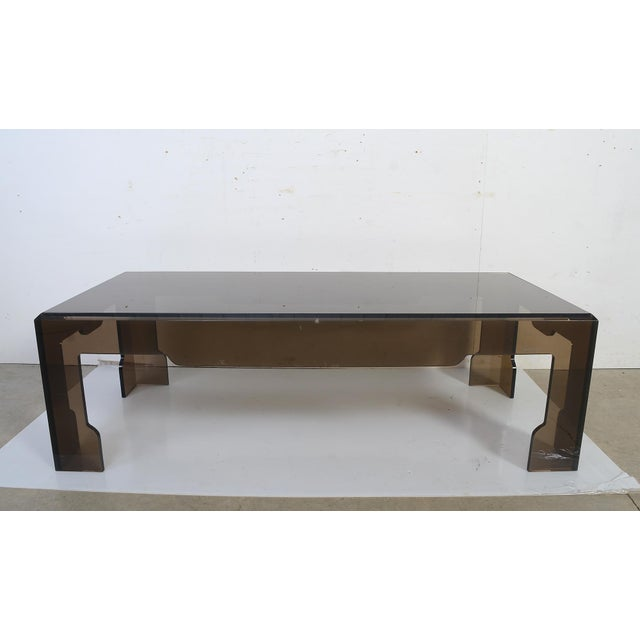 Jeffrey Bigelow smoked lucite glass coffee table. Top is smoked glass. Base is lucite. Signed. Good vintage condition....