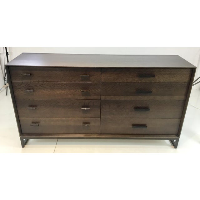 Stylish Caracole modern Artisan walnut finished dresser, black metal frame and hardware, eight drawers with dueling unique...
