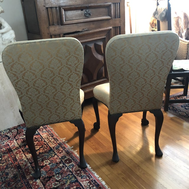 Pair of 18th Century George II Walnut or Mahogany Side Chairs. The wood frames are all 100% original and have been...