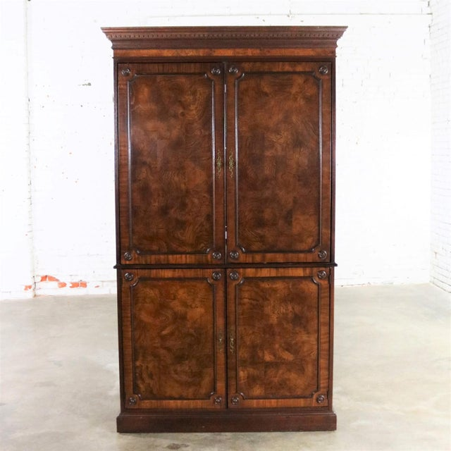 Handsome and stately large mahogany veneered entertainment armoire or wardrobe cabinet by Hekman Comfortable Living...