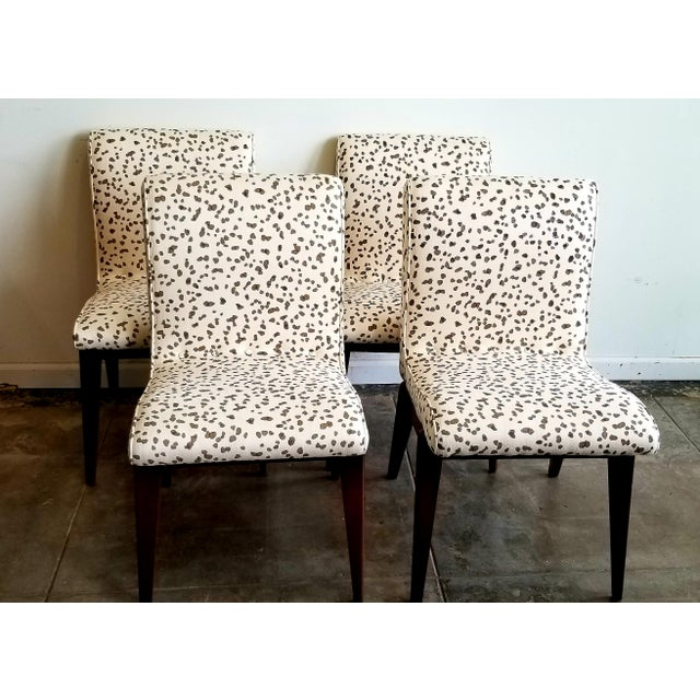 Set of 4 Mid Century Dining Chairs reupholstered in Peter Fasano Dotty Fabric.