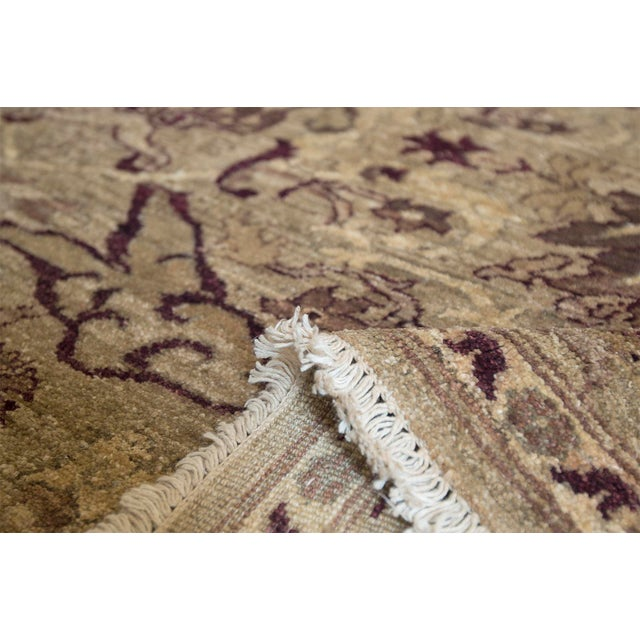 Handwoven by master weavers in Pakistan, this beautiful rug features a brilliant color combination and a distinctive...