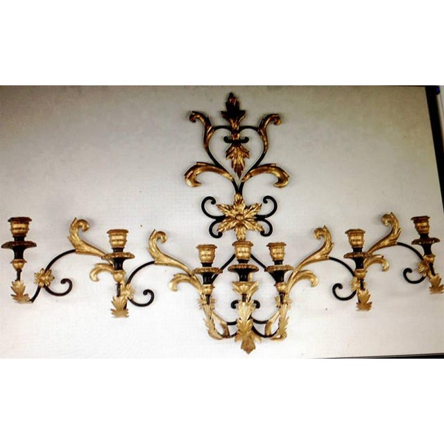 Striking seven-arm monumental wall sculpture or wall sconce.