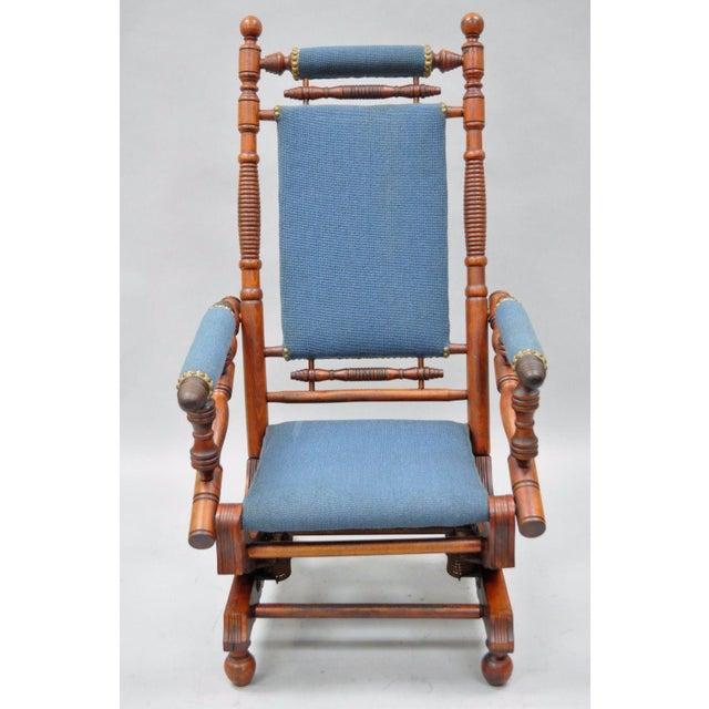 An Antique American Eastlake Victorian Period Platform Rocking Chair.  Details: Solid Walnut Turned Construction - Antique Eastlake Victorian Turned Walnut Blue Platform Rocking Chair
