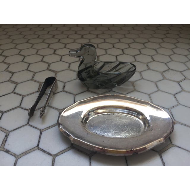This silver plated server dish with tongs includes a crystal duck dish and convenient tongs. Purchased in England. Not...
