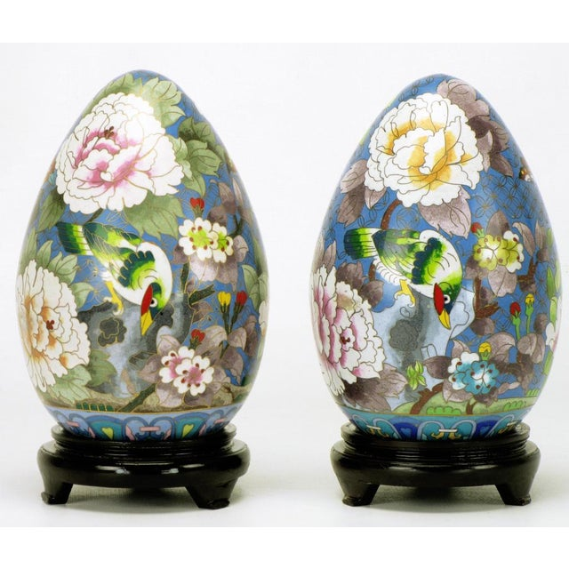 Excellent pair of large cloisonne eggs with colorful bird and flower detailing in blue, green, white, rose, yellow and...