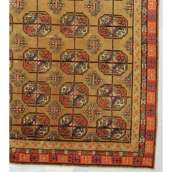 This handmade vintage Turkish rug measures approximately 5 x 10 and dates back to the 1930's. Framed with a triple border...
