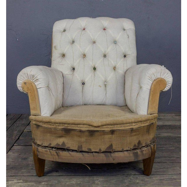 French tufted armchair with matching ottoman. Sold as is, upholstery available, price upon request. Ottoman measurements:...