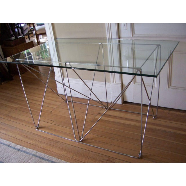 Can be used as a desk or console piece, can hold a larger slab of glass if needed. This desk is collapsible. Very solid...