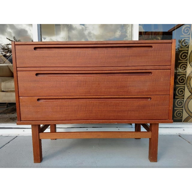 This is a great mid-century, Danish Modern teak vanity. The top drawer is actuality vanity compartment that pulls out to...