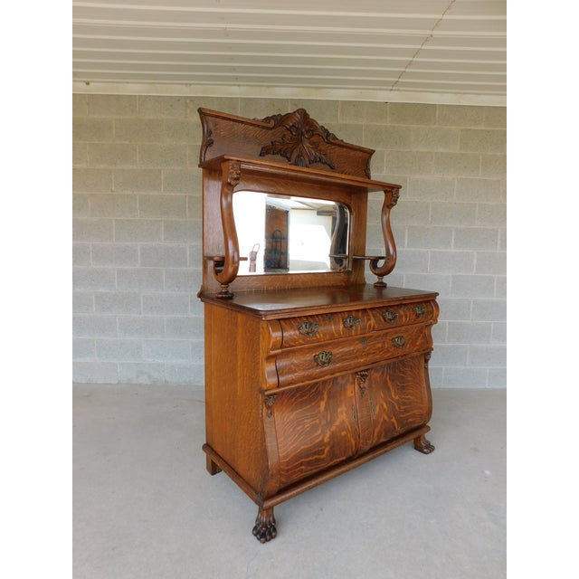Features Quality Solid Construction, Figured Wood Grain, 3 Dovetailed Drawers, 2 Lower Doors , Paw Feet , Lions Head...