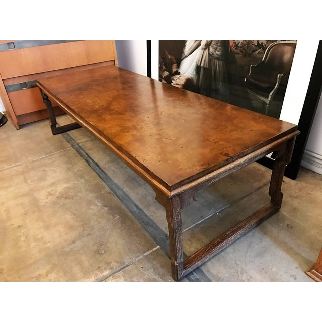 A wonderful 1960s cocktail table with a cerused limed wood base and a polished burl match-booked walnut top. Original label.