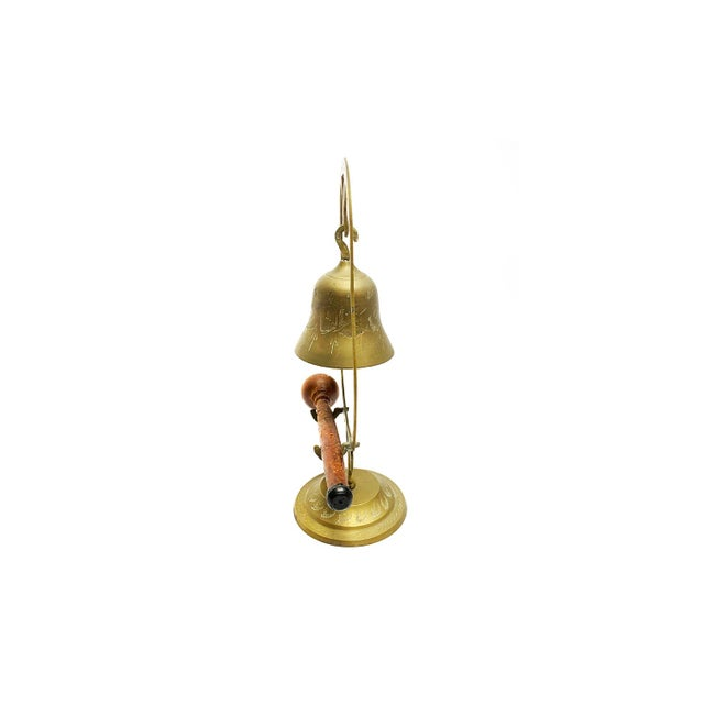 Vintage mid century hand made and etched hanging brass bell with wooden mallet. This makes for a perfect dinner gong, a...