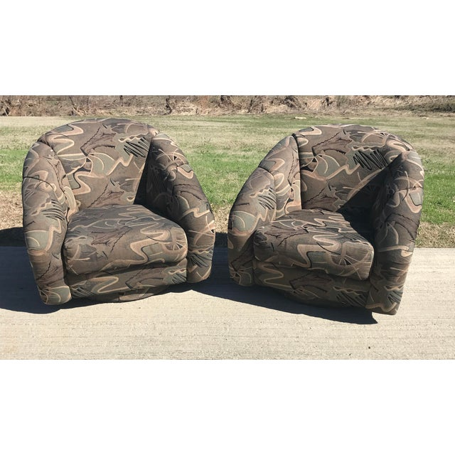 Beautiful curvy Milo Baughman Swivel barrel Lounge Chairs with upholstered plinth base. Fabric is in great condition but...