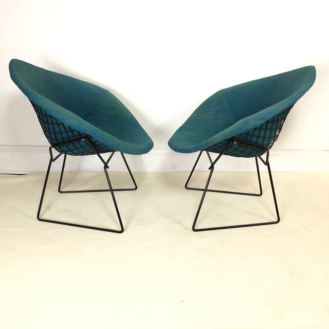 Rare early production of the diamond chair by Harry Bertoia. with original gorgeous upholstery by Alexander Girard. Frames...