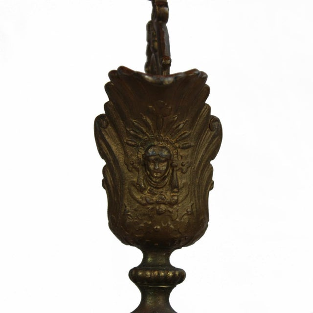 "Antique French cast bronze ewer with cherubs measures 20'' high and 7"" across from spout to handle."