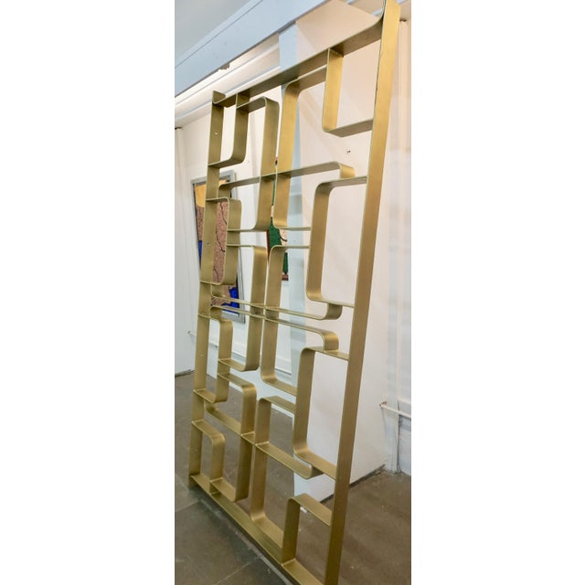 Heavy solid steel room divider or screen with gold tone.Drilled holes for mounting to walls. Can be used indoors or outdoors