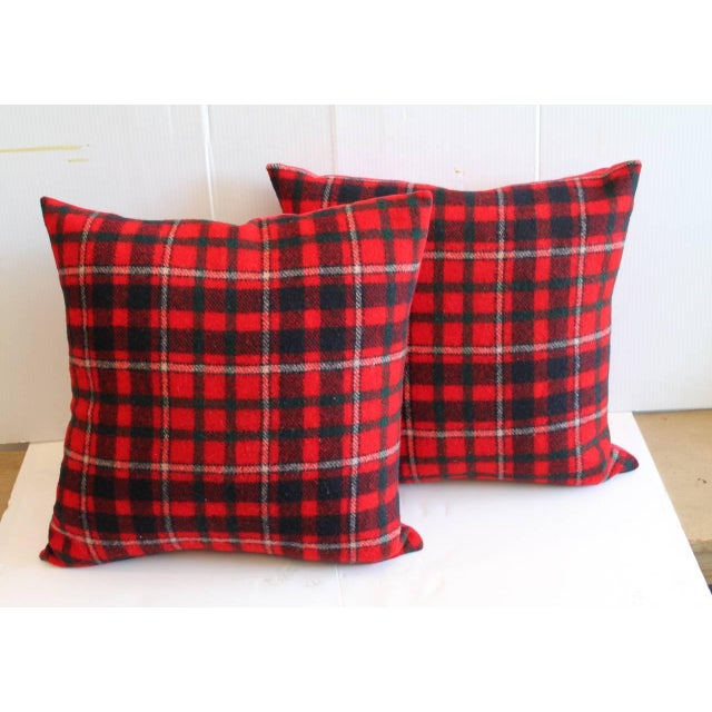 Wonderful and festive red and blue Pendleton blanket pillows. Backing is in red cotton linen. Down and feather fill. Two...